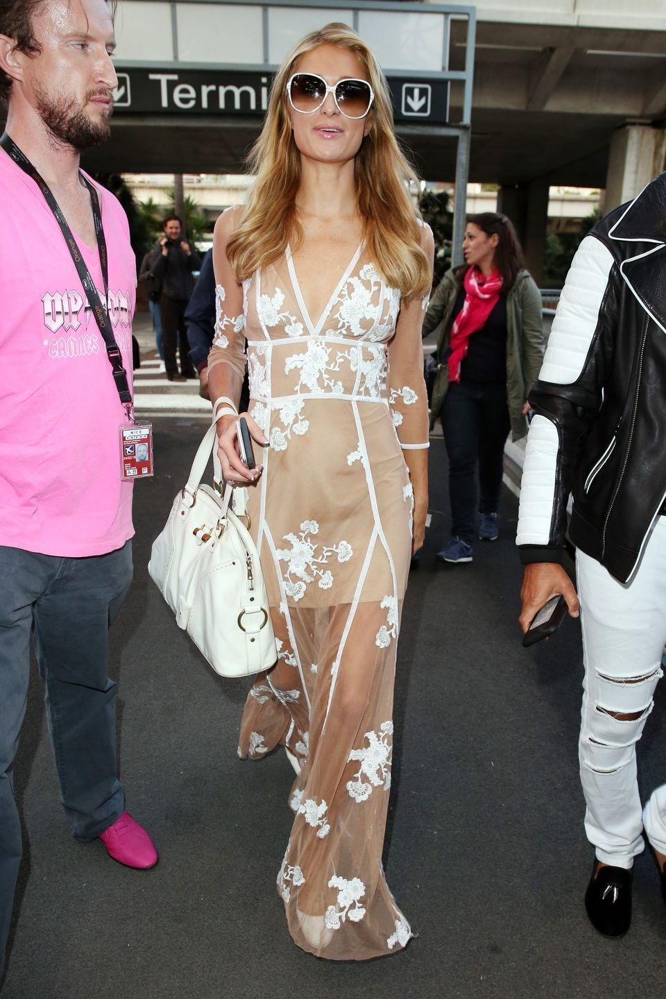 <p><strong>Paris Hilton, 2016: </strong>Needs to take her sunglasses off and watch where she's stepping in this gown and heels situation.</p>