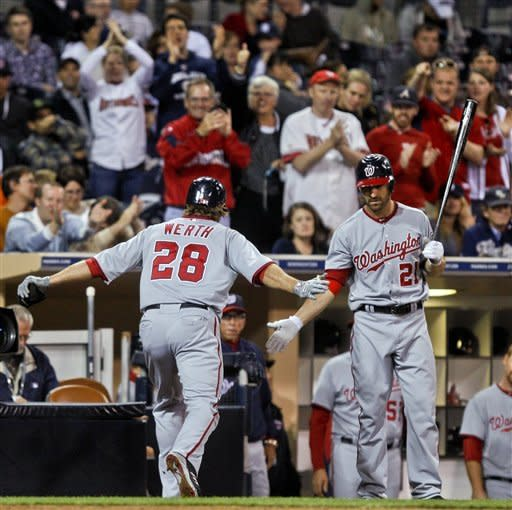Washington Nationals' Jayson Werth celebrates with Xavier Nady after his solo home run in the seventh inning against the San Diego Padres during a baseball game Thursday, April 26, 2012, in San Diego. (AP Photo/Lenny Ignelzi)