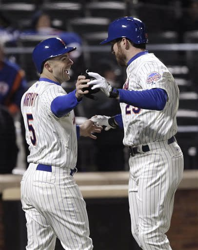 New York Mets' Ike Davis, right, is congratulated at home plate by David Wright after hitting a two-run home run off San Diego Padres starting pitcher Clayton Richard in the fifth inning of a baseball game, Wednesday, April 3, 2013 in New York. (AP Photo/Mark Lennihan)