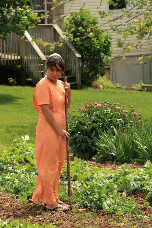 "Sabrina working in the garden on TLC's ""Breaking Amish."""