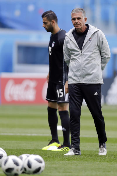 Iran head coach Carlos Queiroz walks on the pitch during the official training of Iran on the eve of the group B match between Morocco and Iran at the 2018 soccer World Cup in the St. Petersburg Stadium in St. Petersburg, Russia, Thursday, June 14, 2018. (AP Photo/XXXX)