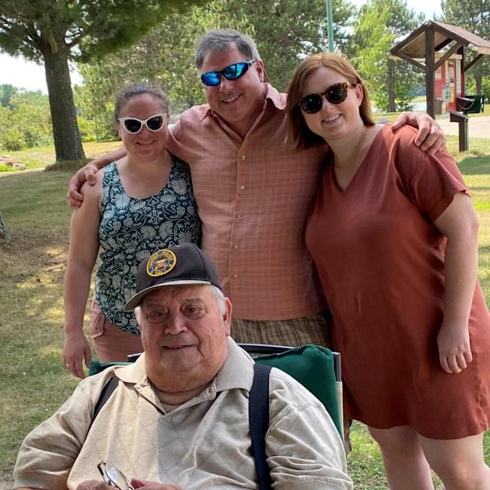 Julie Welch's father-in-law, Russ, is seen along with her husband, Brett, and daughters, Ellie and Anna, during a park get-together in June 2020. Russ died on March 16, 2021. (Courtesy of Julie Welch)