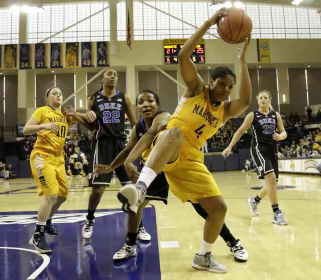 Marquette's Arlesia Morse, right, pulls down the rebound against Duke's Richa Jackson, center, during the first half of a woman's NCAA college basketball game Sunday, Nov. 24, 2013, in Milwaukee. (AP Photo/Darren Hauck)