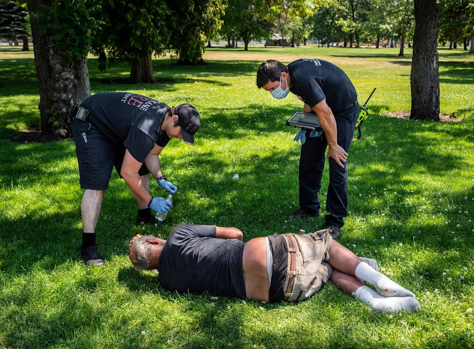 EMTs in Spokane, Washington check on a resident amid extreme heat conditions