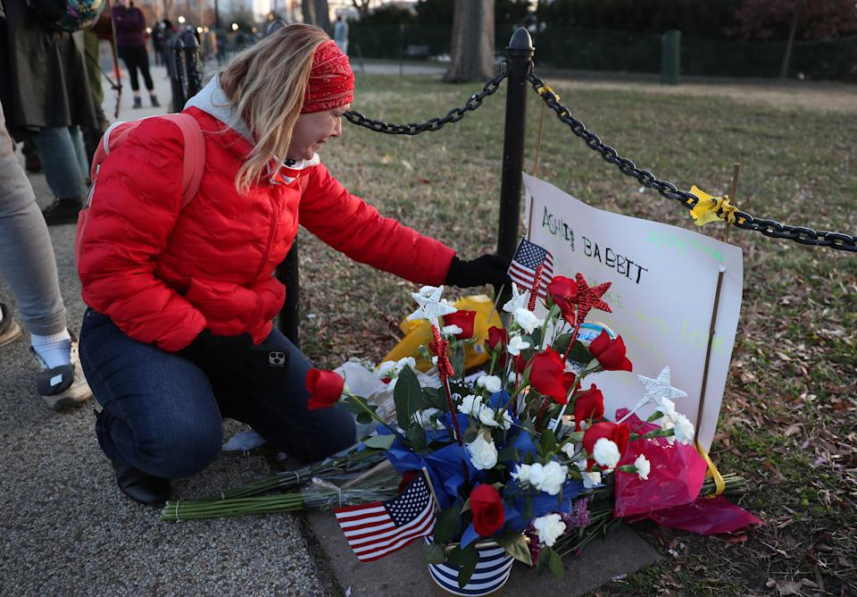 Melody Black, from Minnesota, becomes emotional while visiting a memorial setup near the U.S. Capitol Building for Ashli Babbitt on Jan. 7, 2021. Babbitt was killed after she and a pro-Trump mob broke into the building on Jan. 6.  (Joe Raedle/Getty Images)