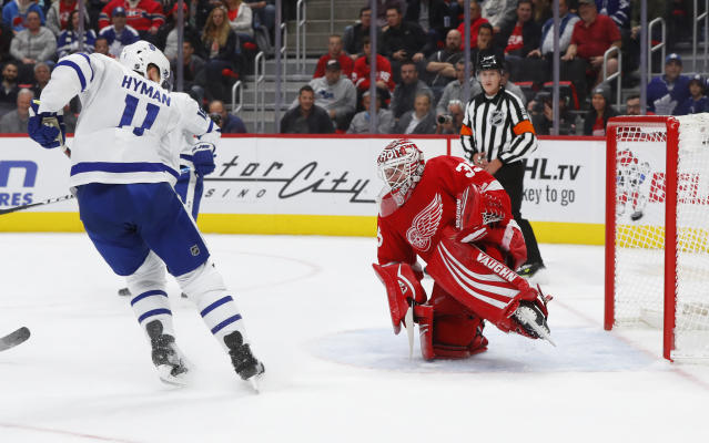 Toronto Maple Leafs center Zach Hyman (11) watches a Morgan Rielly shot go in for a goal on Detroit Red Wings goaltender Jimmy Howard (35) during the first period of an NHL hockey game Thursday, Oct. 11, 2018, in Detroit. (AP Photo/Paul Sancya)