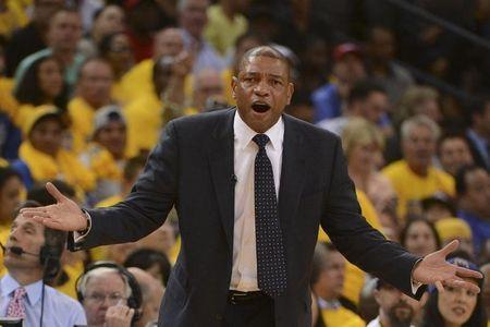 May 1, 2014; Oakland, CA, USA; Los Angeles Clippers head coach Doc Rivers reacts against the Golden State Warriors during the first quarter in game six of the first round of the 2014 NBA Playoffs at Oracle Arena. Mandatory Credit: Kyle Terada-USA TODAY Sports