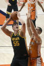 Iowa's center Luka Garza (55) shoots as Illinois forward Giorgi Bezhanishvili defends in the first half of an NCAA college basketball game Friday, Jan. 29, 2021, in Champaign, Ill. (AP Photo/Holly Hart)