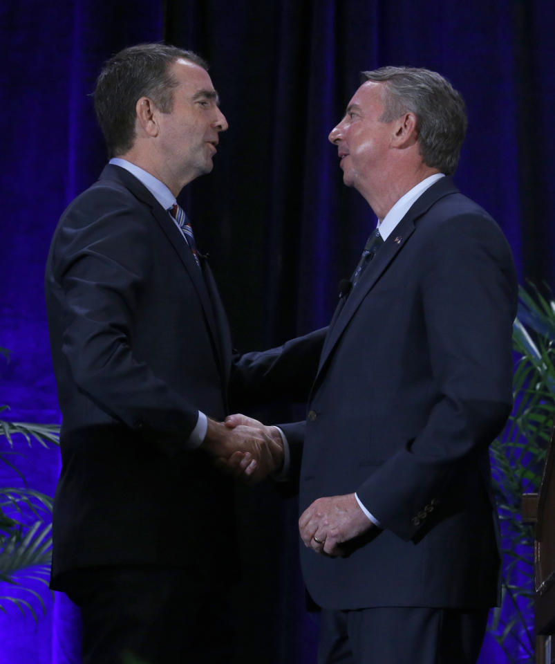 Democratic gubernatorial candidate Lt. Gov. Ralph Northam, left, and GOP gubernatorial candidate Ed Gillespie, shake hands on stage at the Omni Homestead Resort in Hot Springs, Va., Saturday, July 22, 2017. The two major party candidates in Virginia's closely watched race for governor clashed at their first debate over President Donald Trump, health care, immigration, and social issues. ( Bob Brown/Richmond Times-Dispatch via AP)