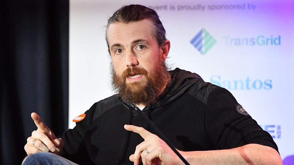 Atlassian co-founder and tech billionaire Mike Cannon-Brookes is seen here giving a speech.