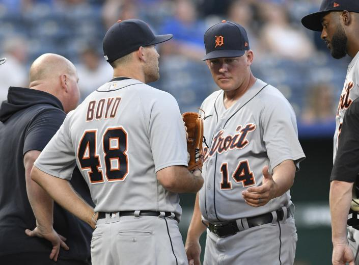 Detroit Tigers starting pitcher Matthew Boyd (48) comes out of a baseball game after talking to manager A.J. Hinch (14) during the third inning of a baseball game against the Kansas City Royals in Kansas City, Mo., Monday, June 14, 2021. (AP Photo/Reed Hoffmann)