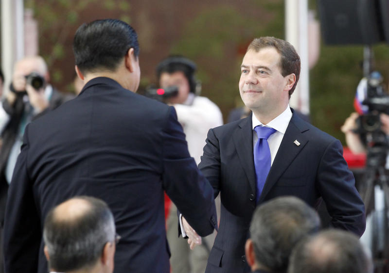 Russian President Dmitry Medvedev, right, and China's Vice President Xi Jinping, left, shake hands during the opening ceremony of the Russian Pavilion National Day celebration at the Shanghai Expo site in Shanghai Tuesday, Sept. 28 2010. (AP Photo/Eugene Hoshiko)