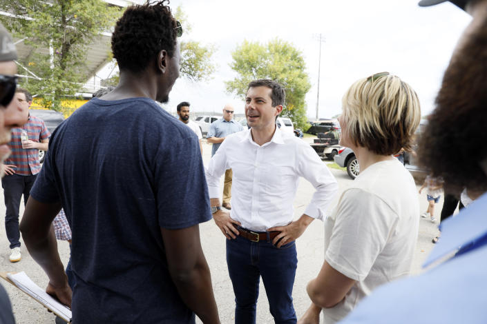 Democratic presidential candidate Pete Buttigieg talks with attendees at the Hawkeye Area Labor Council Labor Day Picnic, Monday, Sept. 2, 2019, in Cedar Rapids, Iowa. (AP Photo/Charlie Neibergall)