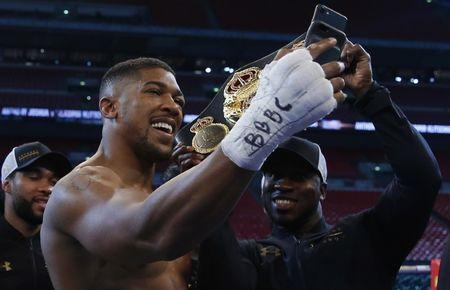 Britain Boxing - Anthony Joshua v Wladimir Klitschko IBF, IBO & WBA Super World Heavyweight Title's - Wembley Stadium, London, England - 29/4/17 Anthony Joshua takes a selfie video after the fight Action Images via Reuters / Andrew Couldridge Livepic