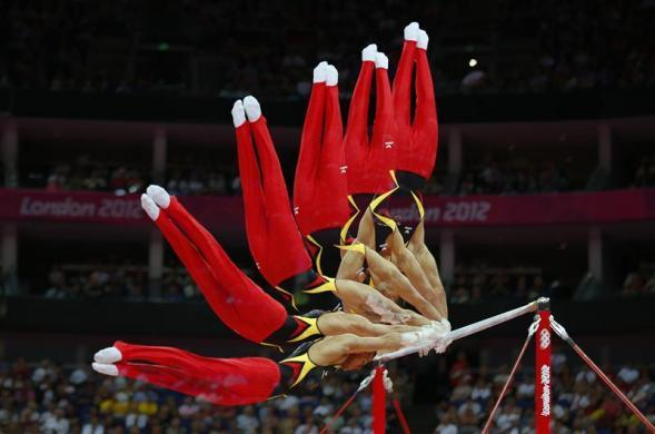 Sebastian Krimmer of Germany competes in the horizontal bar event during the men's gymnastics qualification in the North Greenwich Arena during the London 2012 Olympic Games July 28, 2012.