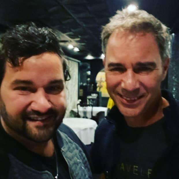 Andrew Perry, left, got to meet his hero, actor Eric McCormack, during a visit to St. John's last week.  (Submitted by Andrew Perry - image credit)