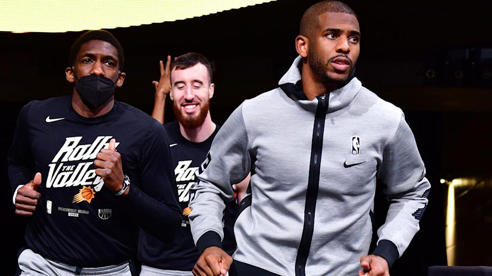 Chris Paul and Phoenix Suns teammates, pictured here before a game against the Denver Nuggets.