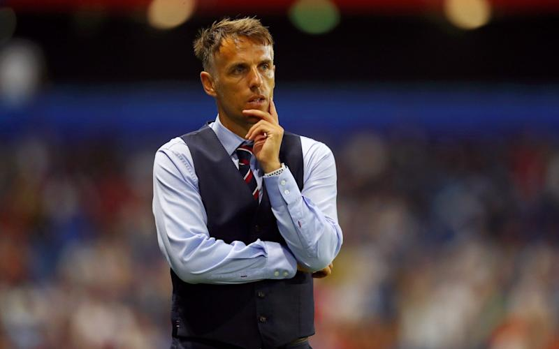 Phil Neville has followed Gareth Southgate in making the waistcoat a trademark of his success - FIFA
