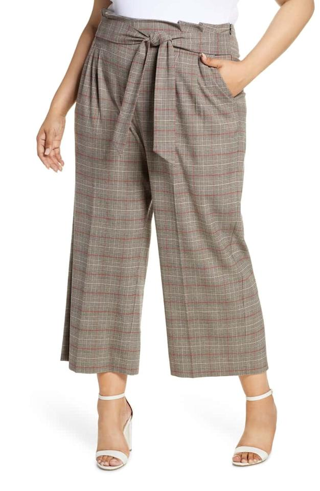 """<p>Wear these <a href=""""https://www.popsugar.com/buy/1STATE-Acoustic-Plaid-Paperbag-Waist-Crop-Pants-484446?p_name=1.STATE%20Acoustic%20Plaid%20Paperbag%20Waist%20Crop%20Pants&retailer=shop.nordstrom.com&pid=484446&price=99&evar1=fab%3Aus&evar9=46550045&evar98=https%3A%2F%2Fwww.popsugar.com%2Ffashion%2Fphoto-gallery%2F46550045%2Fimage%2F46550054%2F1STATE-Acoustic-Plaid-Paperbag-Waist-Crop-Pants&list1=shopping%2Cnordstrom%2Cfall%20fashion%2Cfall%2Ccurvy%20fashion&prop13=mobile&pdata=1"""" rel=""""nofollow"""" data-shoppable-link=""""1"""" target=""""_blank"""" class=""""ga-track"""" data-ga-category=""""Related"""" data-ga-label=""""https://shop.nordstrom.com/s/1-state-acoustic-plaid-paperbag-waist-crop-pants-plus-size/5318953?origin=category-personalizedsort&amp;breadcrumb=Home%2FWomen%2FClothing%2FPlus-Size%20Clothing%2FAll%20Plus-Size%20Clothing&amp;color=rich%20black"""" data-ga-action=""""In-Line Links"""">1.STATE Acoustic Plaid Paperbag Waist Crop Pants</a> ($99) to work and beyond.</p>"""