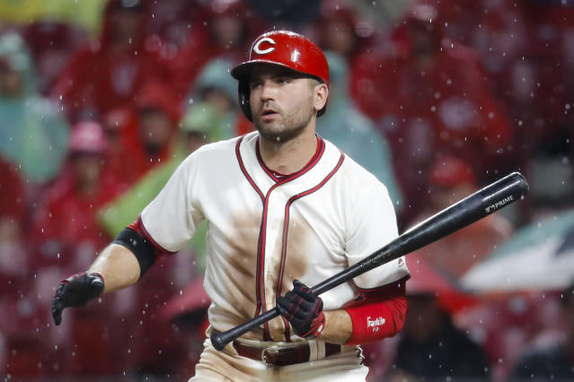 Cincinnati Reds' Joey Votto reacts after striking out looking against Texas Rangers relief pitcher Jose Leclerc during the eighth inning of a baseball game Saturday, June 15, 2019, in Cincinnati. (AP Photo/John Minchillo)