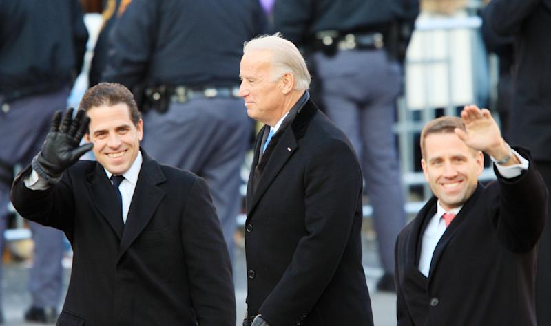 Vice President Joe Biden (C) and his sons, Hunter (L) and Beau, pictured during the Inaugural Parade in Washington, DC, on January 20, 2009 (AFP Photo/David Mcnew)