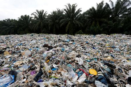 Plastic waste is piled outside an illegal recycling factory in Jenjarom, Kuala Langat, Malaysia October 14, 2018. REUTERS/Lai Seng Sin/Files