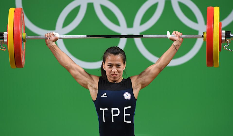 Taiwan's Hsing-Chun Kuo competes in the Women's 58kg weightlifting competition at the Rio 2016 Olympic Games in Rio de Janeiro on August 8, 2016.  / AFP / GOH Chai Hin        (Photo credit should read GOH CHAI HIN/AFP via Getty Images)