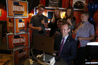 Rep. Ben McAdams, D-Utah, is interviewed over Zoom with his family, son James, left, daughter Kate, son Isaac, wife Julie, and son Robert, at Pat's Barbecue on election night, Tuesday, Nov. 3, 2020, in Salt Lake City. McAdams is trying to win a second term and is being challenged by Republican Burgess Owens. (Laura Seitz/The Deseret News via AP)