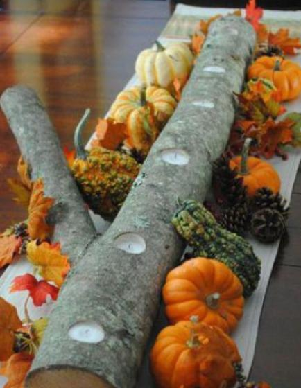 """<div class=""""caption-credit""""> Photo by: StyleCaster</div>Create a stunning rustic centerpiece by using items found in your own backyard. This one is much easier to recreate than it looks. The log filled with tea lights is simple and beautiful on it's own, but you can easily dress it up with other fall favorites, such as miniature gourds and pinecones. <br> Image Via Sas Interiors"""