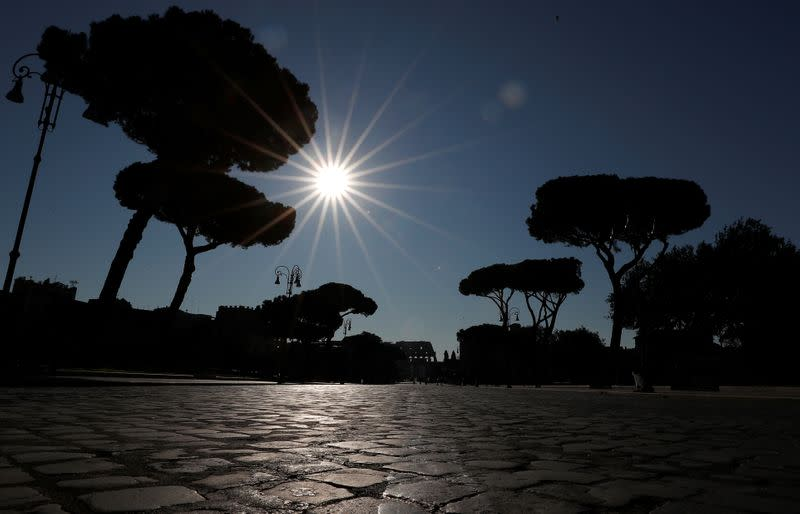 A virtually deserted street near the Colosseum is pictured after a decree orders for the whole of Italy to be on lockdown in an unprecedented clampdown aimed at beating the coronavirus, in Rome