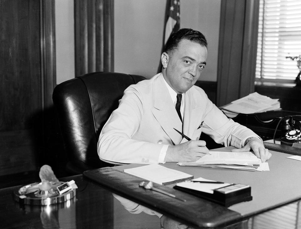 F.B.I. director J. Edgar Hoover is seen in his Washington office, date unknown.  (AP Photo)