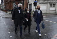 """Wikileaks spokesman Kristinn Hrafnsson, left, with Stella Moris girlfriend of Julian Assange, center, and Joseph A Farrell of Wikileaks walk towards Westminster Magistrates Court for his Bail hearing in London, Wednesday, Jan. 6, 2021. On Monday Judge Vanessa Baraitser ruled that Julian Assange cannot be extradited to the US. because of concerns about his mental health. Assange had been charged under the US's 1917 Espionage Act for """"unlawfully obtaining and disclosing classified documents related to the national defence"""". Assange remains in custody, the US. has 14 days to appeal against the ruling. (AP Photo/Matt Dunham)"""