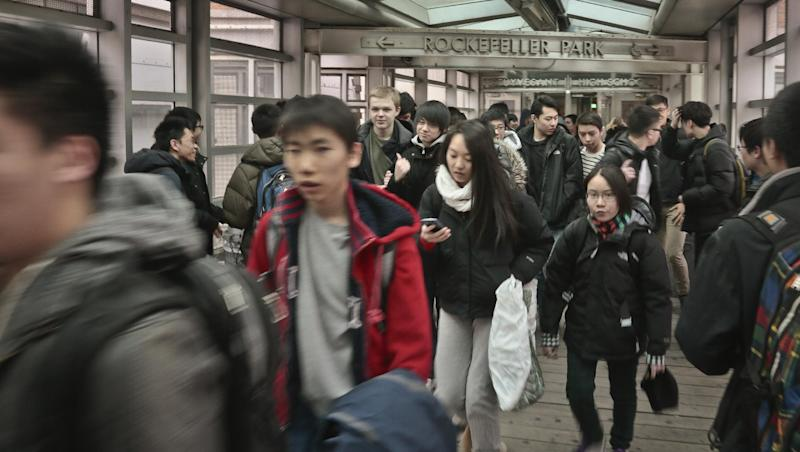 In this March 25, 2014 photo, students leave Stuyvesant High School, one of the nine specialized public high schools in New York City. New York state has the most segregated public schools in the nation, according to a report released Wednesday by the Civil Rights Project at the University of California at Los Angeles. (AP Photo/Bebeto Matthews)