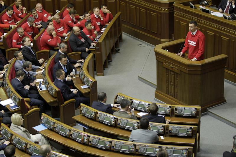Lawmaker and Chairman of the Ukrainian opposition party Udar (Punch) and WBC Heavyweight Champion boxer Vitali Klitschko, speaks to lawmakers during the parliament session in Kiev, Ukraine, Wednesday, Nov. 13, 2013. Ukraine's parliament on Wednesday delayed a key vote on the release of jailed former Ukrainian premier Yulia Tymoshenko, a move that threatens to derail this ex-Soviet republic's push towards the European Union and move Kiev back into Russia's orbit.(AP Photo/Sergei Chuzavkov)