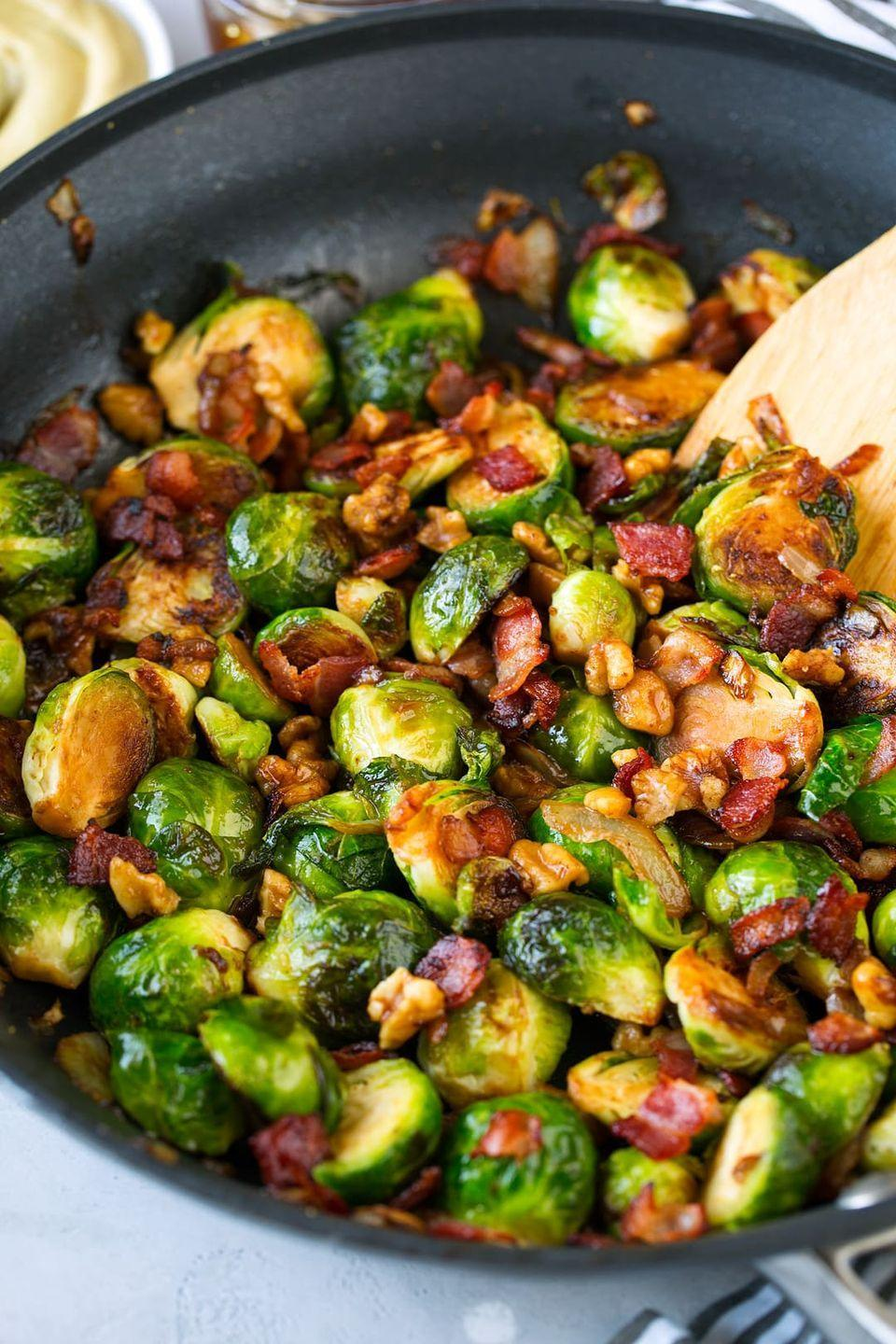 """<p>Some things are just better together: peanut butter and jelly, salt and pepper, and Brussels sprouts and bacon! A honey-Dijon mustard sauce adds some extra sweetness to the combo.</p><p><strong>Get the recipe from <a href=""""https://www.cookingclassy.com/sauteed-brussels-sprouts-with-bacon-onions-and-walnuts/"""" rel=""""nofollow noopener"""" target=""""_blank"""" data-ylk=""""slk:Cooking Classy"""" class=""""link rapid-noclick-resp"""">Cooking Classy</a>.</strong></p>"""