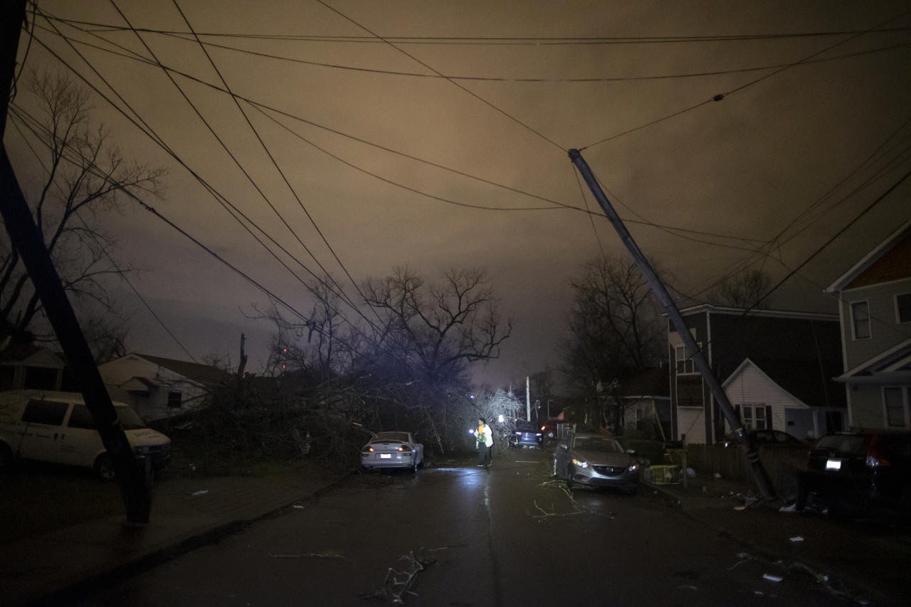 NASHVILLE, TN - MARCH 03:  A resident makes her way down Underwood St. amidst downed trees and heavy debris on March 3, 2020 in Nashville, Tennessee. A tornado passed through Nashville just after midnight leaving a wake of damage in its path including two people killed in East Nashville. (Photo by Brett Carlsen/Getty Images)