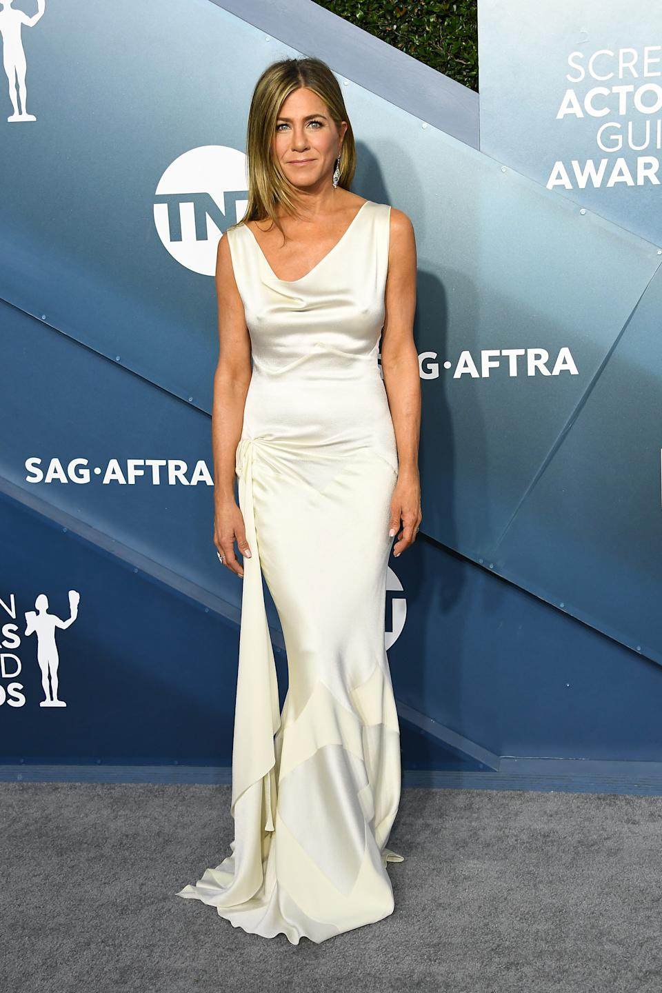 """""""The Morning Show"""" star ditched her go-to little black dress in favour of a grecian-inspired ivory gown."""