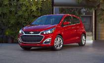 """<p>The <a href=""""https://www.caranddriver.com/mitsubishi/mirage"""" rel=""""nofollow noopener"""" target=""""_blank"""" data-ylk=""""slk:Chevy Spark"""" class=""""link rapid-noclick-resp"""">Chevy Spark</a> is GM's smallest model and the <a href=""""https://www.caranddriver.com/features/g29414710/10-cheapest-new-cars-for-2020/"""" rel=""""nofollow noopener"""" target=""""_blank"""" data-ylk=""""slk:least expensive new car in America"""" class=""""link rapid-noclick-resp"""">least expensive new car in America</a>. The tiny five-door hatchback isn't exactly lust worthy, but it's a strong value, offers high quality and drives better than a $14,000 car should. With its 98-hp four-cylinder and the optional CVT automatic, it's also a rocket ship compared to its rival, the Mitsubishi Mirage. In our testing, the front-wheel drive Spark reached 60 mph in 10.7 seconds, and it's probably a bit quicker with the five-speed manual, which is available on all trim levels.</p><p>Unfortunately it also requires 7.6 seconds to go from 50 to 70 mph. When merging onto a highway, full throttle isn't suggested, it's required. With the CVT, its fuel economy ratings of 29 mpg city and 38 mpg highway are also a bit disappointing for such a small vehicle. Inside, a large 7.0-inch touchscreen is standard, along with Apple CarPlay and Android Auto integration.</p>"""