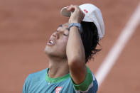 Japan's Kei Nishikori holds his cap as he plays Italy's Alessandro Giannessi during their first round match of the French Open tennis tournament at the Roland Garros stadium Sunday, May 30, 2021 in Paris. (AP Photo/Thibault Camus)