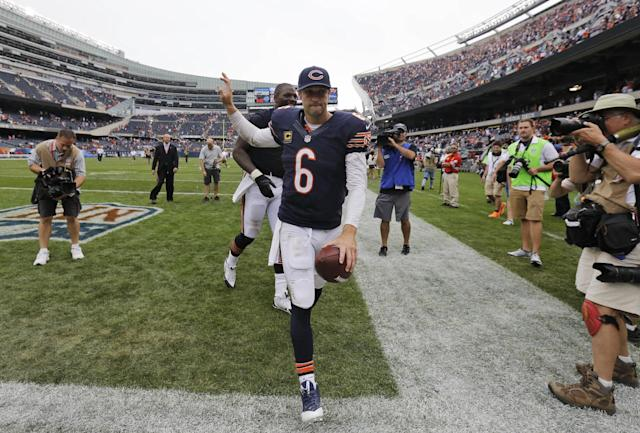 Chicago Bears quarterback Jay Cutler runs off the field after the Bears' 24-21 win over the Cincinnati Bengals in an NFL football game, Sunday, Sept. 8, 2013, in Chicago. (AP Photo/Nam Y. Huh)