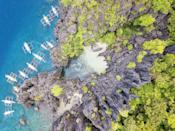 """<p>White sand disguised behind colossal cliffs, this beach can be accessed by swimming through an opening in the rock formation—which likely explains why Hidden Beach is also known as <a href=""""https://www.thepoortraveler.net/2012/02/secret-beach-el-nido-palawan/"""" rel=""""nofollow noopener"""" target=""""_blank"""" data-ylk=""""slk:Secret Beach"""" class=""""link rapid-noclick-resp"""">Secret Beach</a>. Luckily, you can also appreciate its beauty from overhead without having to traverse the turquoise waters.</p>"""