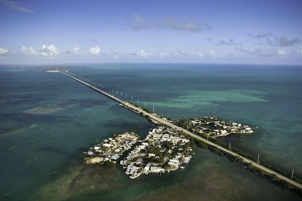 "<p>The seven-mile bridge in the Florida Keys is the closest you'll get to feeling like you're driving in the Caribbean without actually leaving American soil.</p><p><em><br></em></p><p><em><a href=""https://subscribe.hearstmags.com/subscribe/womansday/253396?source=wdy_edit_article"" rel=""nofollow noopener"" target=""_blank"" data-ylk=""slk:Subscribe to Woman's Day"" class=""link rapid-noclick-resp"">Subscribe to Woman's Day</a> today and get <strong>73% off your first 12 issues</strong>. And while you're at it, <a href=""https://subscribe.hearstmags.com/circulation/shared/email/newsletters/signup/wdy-su01.html"" rel=""nofollow noopener"" target=""_blank"" data-ylk=""slk:sign up for our FREE newsletter"" class=""link rapid-noclick-resp"">sign up for our FREE newsletter</a> for even more of the Woman's Day content you want.</em><br></p>"