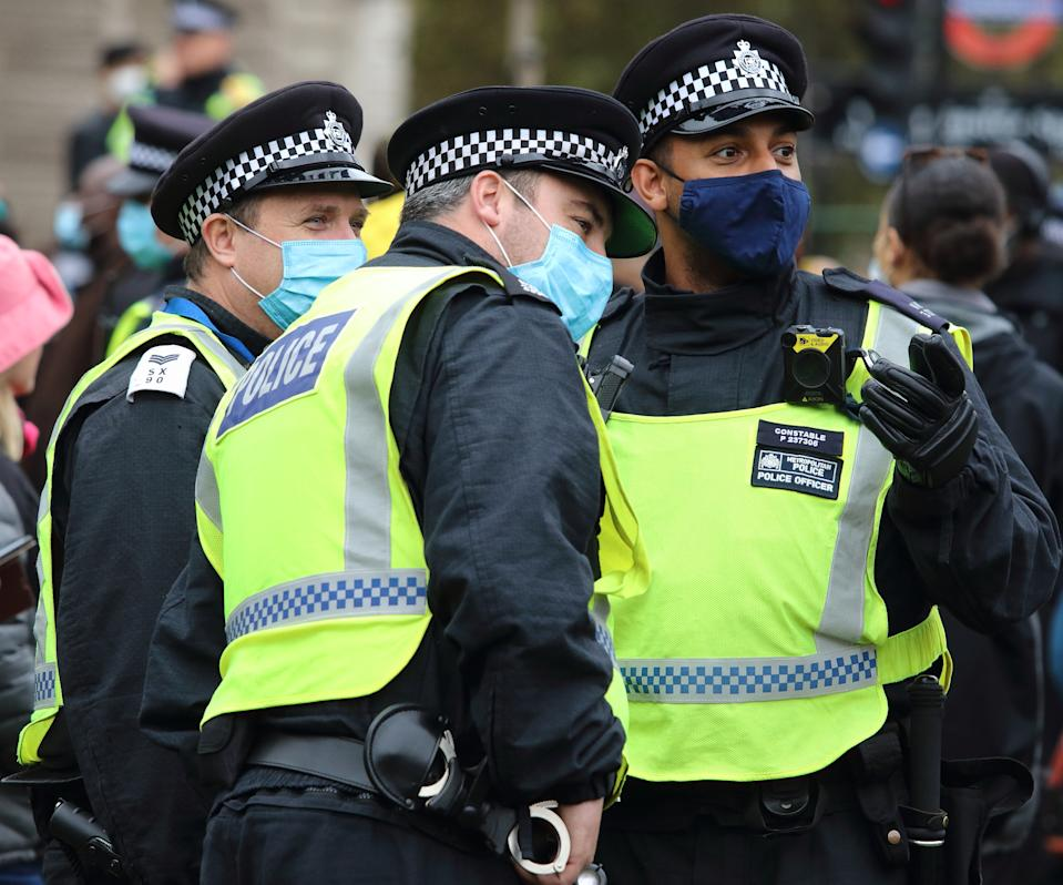 Police officers wearing facemasks are seen having a conversation before the start of the protest. With a number of expected demonstrations taking place in the capital this weekend, the Metropolitan Police mobilized staffing from all quarters. Territorial Support Group (TSG) the Met's Public Order operating unit, Mounted police, motorbikes and other vehicles plus a large number of officers on foot. (Photo by Keith Mayhew / SOPA Images/Sipa USA)