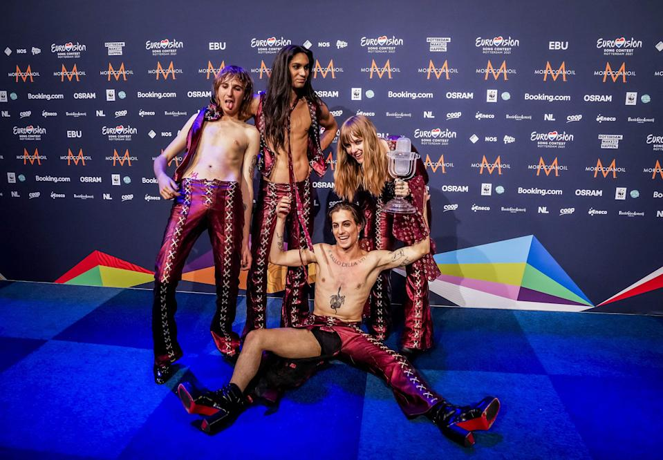 <p>Italy's Maneskin pose with their trophy at the end of a press conference after winning the final of the 65th Eurovision Song Contest at the Ahoy convention centre in Rotterdam</p> (AFP)