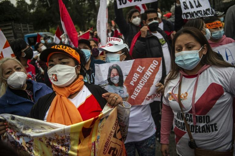 Supporters of right-wing candidate Keiko Fujimori rally in downtown Lima, as rival leftist Pedro Castillo is narrowly ahead in the official vote count