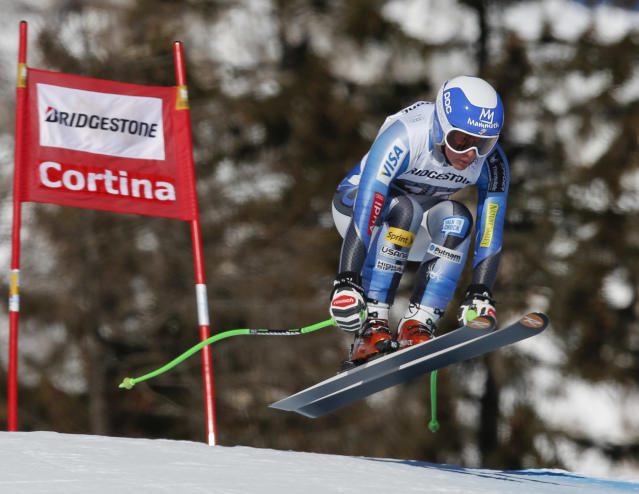 Stacey Cook of the United States speeds down the course during an alpine ski, women's World Cup downhill, in Cortina D'Ampezzo, Italy, Saturday, Jan. 25, 2014. Stacey Cook shared the 5th place with Anna Fenninger of Austria. (AP Photo/Marco Trovati)