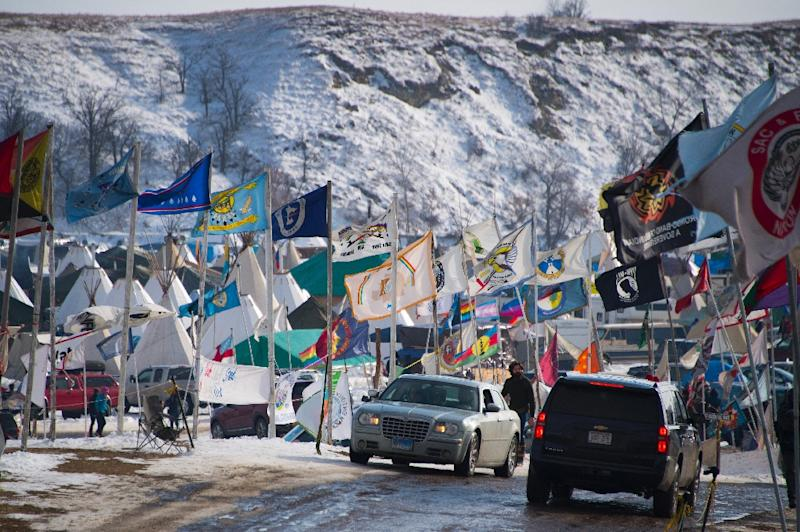 Flags flap in the wind on the main thoroughfare of Oceti Sakowin Camp on the edge of the Standing Rock Sioux Reservation on December 3, 2016 outside Cannon Ball, North Dakota