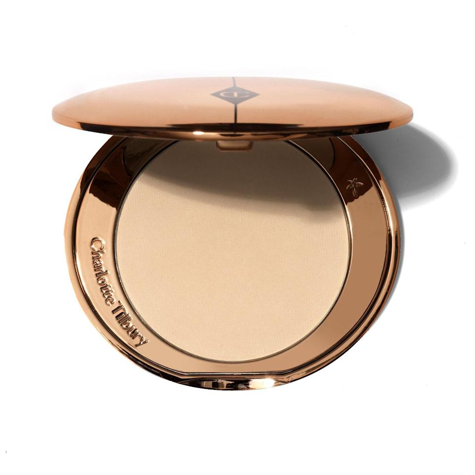 """The Airbrush Flawless Finish Setting Powder isn't your typical <a href=""""https://www.allure.com/gallery/best-setting-powder?mbid=synd_yahoo_rss"""" rel=""""nofollow noopener"""" target=""""_blank"""" data-ylk=""""slk:finishing product"""" class=""""link rapid-noclick-resp"""">finishing product</a>. Yes, it keeps your makeup looking fresh and in place throughout the entire day, but it's also packed with moisturizing rose wax and almond oil for a weightless yet velvety finish. Cakey formulas? We don't know them. You'll also find light-reflecting pearls that instantly brighten your complexion while keeping the shine off of your oily-prone areas. Instagram and TikTok filters can't even compare to this second-skin-like formula. (Hot tip: The <a href=""""https://www.allure.com/review/charlotte-tilbury-airbrush-flawless-setting-spray-review?mbid=synd_yahoo_rss"""" rel=""""nofollow noopener"""" target=""""_blank"""" data-ylk=""""slk:Airbrush Flawless Setting Spray"""" class=""""link rapid-noclick-resp"""">Airbrush Flawless Setting Spray</a> is just as good.)"""