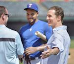 Texas Rangers right fielder Nelson Cruz, center, talks with actor Matthew McConaughey, right, before the game with the Cincinnati Reds at Rangers Ballpark in Arlington, Texas, Saturday, June 29, 2013. (Photo by Max Faulkner/Fort Worth Star-Telegram/MCT/Sipa USA)