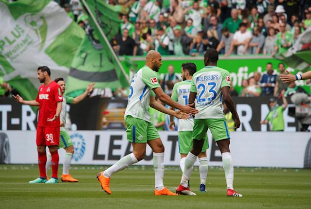 Soccer Football - Bundesliga - VfL Wolfsburg v FC Cologne - Volkswagen Arena, Wolfsburg, Germany - May 12, 2018 Wolfsburg's Josuha Guilavogui celebrates scoring their first goal with teammates REUTERS/Wolfgang Rattay DFL RULES TO LIMIT THE ONLINE USAGE DURING MATCH TIME TO 15 PICTURES PER GAME. IMAGE SEQUENCES TO SIMULATE VIDEO IS NOT ALLOWED AT ANY TIME. FOR FURTHER QUERIES PLEASE CONTACT DFL DIRECTLY AT + 49 69 650050